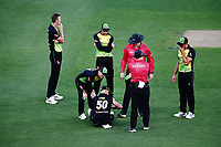 Chris Lynn of Australia is injured after attempting to field a ball. New Zealand Black Caps v Australia, Final of Trans-Tasman Twenty20 Tri-Series cricket. Eden Park, Auckland, New Zealand. Wednesday 21 February 2018. © Copyright Photo: Anthony Au-Yeung / www.photosport.nz