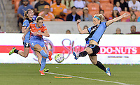 Julie Johnston (8) of the Chicago Red Stars attempts to block a kick by Kealia Ohai (7) of the Houston Dash in the first half on Saturday, April 16, 2016 at BBVA Compass Stadium in Houston Texas.