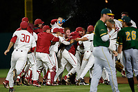 STANFORD, CA - June 1, 2018: Stanford Baseball wins over Wright State 4-3 with a 13th inning walk-off in its opening game of the NCAA Regionals at Sunken Diamond. Team celebrates after Christian Robinson's walk-off double.
