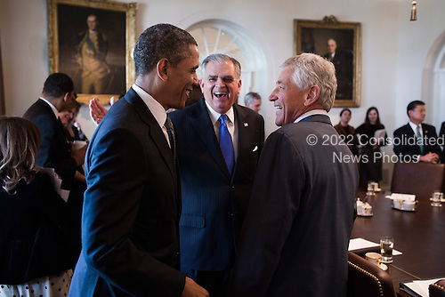 United States President Barack Obama greets Secretary of Transportation Ray LaHood and Secretary of Defense Chuck Hagel before a Cabinet meeting in the Cabinet Room of the White House, March 4, 2013. .Mandatory Credit: Pete Souza - White House via CNP