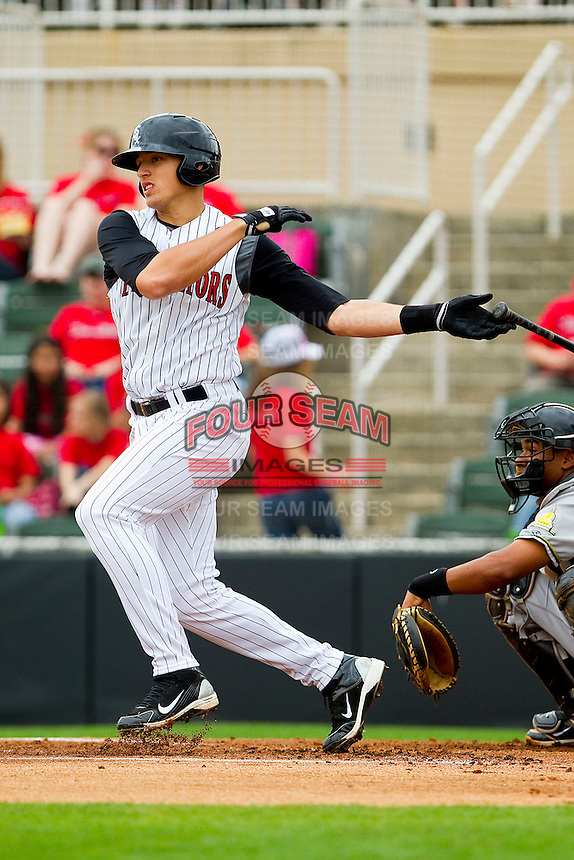 Trayce Thompson #24 of the Kannapolis Intimidators follows through on his swing against the West Virginia Power at Fieldcrest Cannon Stadium on April 20, 2011 in Kannapolis, North Carolina.   Photo by Brian Westerholt / Four Seam Images