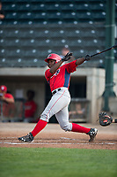 Orem Owlz left fielder Johan Sala (25) follows through on his swing during a Pioneer League game against the Missoula Osprey at Ogren Park Allegiance Field on August 19, 2018 in Missoula, Montana. The Missoula Osprey defeated the Orem Owlz by a score of 8-0. (Zachary Lucy/Four Seam Images)