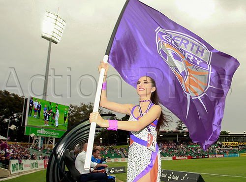 25th March 2018, nib Stadium, Perth, Australia; A League football, Perth Glory versus Melbourne Victory; A Perth Glory Cheer Squad member runs off the pitch with the Glory flag before the start of the match against Melbourne Victory