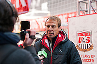 U.S. men's head coach Jurgen Klinsmann is interviewed for television during the centennial celebration of U. S. Soccer at Times Square in New York, NY, on April 04, 2013.