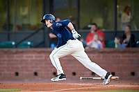 Mobile BayBears second baseman Hutton Moyer (11) runs to first base during a game against the Pensacola Blue Wahoos on April 25, 2017 at Hank Aaron Stadium in Mobile, Alabama.  Mobile defeated Pensacola 3-0.  (Mike Janes/Four Seam Images)