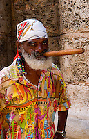 Havana capitol city of Cuba closeup of older man character with long cigar and scarf in Old Havana