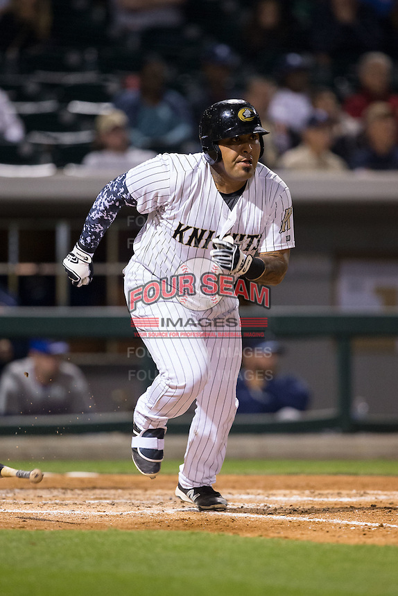 Hector Sanchez (29) of the Charlotte Knights hustles down the first base line against the Durham Bulls at BB&T BallPark on April 14, 2016 in Charlotte, North Carolina.  The Bulls defeated the Knights 2-0.  (Brian Westerholt/Four Seam Images)