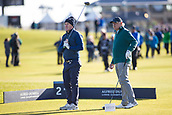 5th October 2017, The Old Course, St Andrews, Scotland; Alfred Dunhill Links Championship, first round; Sir Anthony McCoy tees off on the second while Graeme McDowell  inspects his shot.