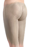 Woman with bentonite clay body wrap mask on her thighs and buttocks