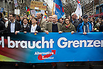 Politicians Alexander Garland (centre) and Beatrix von Storch (right) marching through the streets of Berlin during a demonstration by the Alternative für Deutschland (AfD) political party. Around 5000 supporters of the AfD took part in the march and rally calling on German Chancellor Angela Merkel to halt the influx of refugees into the country. Around one million refugees from the Middle East and north Africa arrived in Germany during 2015, 50,000 of whom came to Berlin.
