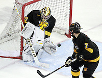 Colorado College goalie Josh Thorimbert sets to grab the puck as Eamonn McDermott looks on. Colorado College defeated Nebraska-Omaha 5-2 Saturday night at CenturyLink Center in Omaha. (Photo by Michelle Bishop) .