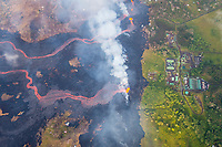 May 2018: An aerial view of lava approaching the Puna Geothermal Venture in Leilani Estates, Puna, Big Island of Hawai'i.