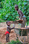 As his younger sibling watches, a boy in Karonga, a town in northern Malawi.