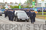 The funeral of Garda Adrian Hickey leaving McElligotts funeral home, Tralee for Blarney on Wednesday.