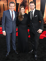 "HOLLYWOOD, LOS ANGELES, CA, USA - MAY 08: Bryan Cranston, Elizabeth Olsen, Aaron Taylor-Johnson at the Los Angeles Premiere Of Warner Bros. Pictures And Legendary Pictures' ""Godzilla"" held at Dolby Theatre on May 8, 2014 in Hollywood, Los Angeles, California, United States. (Photo by Xavier Collin/Celebrity Monitor)"