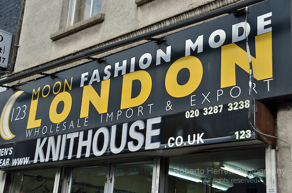 Moon Fashion Mode London Wholesale Import and Export sign, Commercial Road, London, UK.