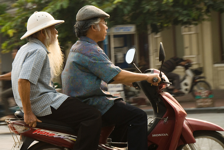 """The elder man on the motorbike has a long beard and a Vietcong hat not unlike Ho Chi Minh or """"Uncle Ho"""" a famous hero to many Vietnamese, especially those in the north."""