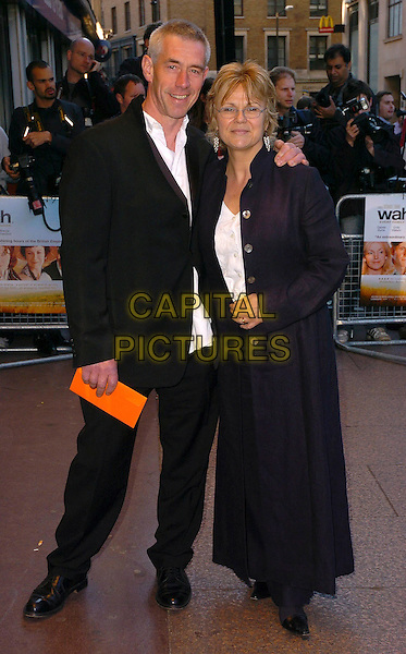 "JULIE WALTERS & GUEST.Arrivals at the UK Film Premiere of ""Wah Wah"", .Odeon Leicester Square, London, England, .May 30th 2006..full length .Ref: CAN.www.capitalpictures.com.sales@capitalpictures.com.©Can Nguyen/Capital Pictures"