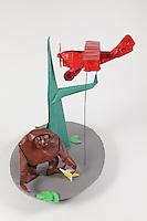 Origami gorilla and biplane folded by Rosalind Joyce. Gorilla designed by Akira Yoshizawa. Tree designed by John Montroll. Biplane designed by Jeremy Shafer. Banana designed by Andrew Hudson.