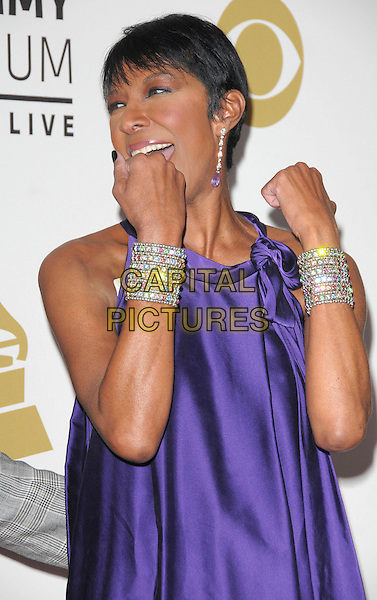 NATALIE COLE <br /> attends The GRAMMY Nominations Concert Live!! held at Nokia Theatre L.A. Live in Los Angeles, California on December 3rd 2008.<br /> half length top silver bracelets hands funny silk satin dangly earrings purple<br /> CAP/DVS<br /> &copy;Debbie VanStory/Capital Pictures