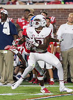 NWA Democrat-Gazette/BEN GOFF @NWABENGOFF<br /> Mike Woods, Arkansas wide receiver, makes a catch under pressure from Keidron Smith, Ole Miss cornerback, in the fourth quarter Saturday, Sept. 7, 2019, at Vaught-Hemingway Stadium in Oxford, Miss.