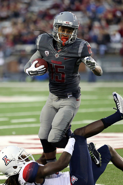 Robert Lewis tries to elude a tackler during the Washington State Cougars Pac-12 conference show down with the Arizona Wildcats at Martin Stadium in Pullman, Washington, on October 25, 2014.