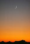 Crescent moon at sunset, North Cascades National Park, Washington
