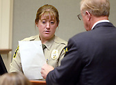 Sergeant Amanda Lambert of the Prince William County, Virginia detention center, looks as a sheet of evidence presented to her by Prince William county (Virginia) commonwealth Attorney, Paul S. Ebert, as she testifies during the penalty phase of the trial of convicted sniper John Allen Muhammad courtroom 10 at the Virginia Beach Circuit Court in Virginia Beach, Virginia on November 20, 2003.<br /> Credit: Lawrence Jackson - Pool via CNP