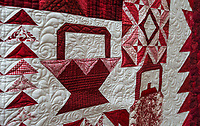 "NWA Democrat-Gazette/ANTHONY REYES @NWATONYR<br /> Quilted flowers coming out of the basket on the ""Farm Girl Goes Red and White"" quilt Monday, April 3, 2017 at the Shiloh Museum in Springdale."