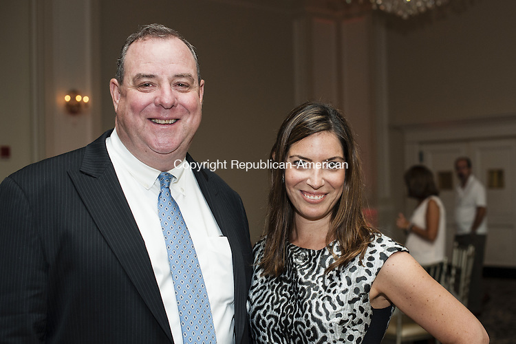 PROSPECT, CT-5 September 2014-090514EC09-  Social Moments. The H.O.P.E. Foundation For a Better Tomorrow held it's inaugural cigar tasting at the Aria Banquet Facility in Prospect, Tuesday August 26th. Waterbury Mayor Neil O'Leary and Nicole DiCocco supported the cause. H.O.P.E. stands for Helping Other People Excel. Nicole's brother coach Frank DiCocco started the foundation, he passed away at age 29 but his family is helping his memory live on through the foundation. Erin Covey Republican-American