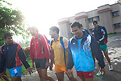 Members of the Indian Kabbadi team are seen walking to the morning training session at a month long camp in Sport Authority of India Sports Complex in Bisankhedi, outskirts of Bhopal, Madhya Pradesh, India.