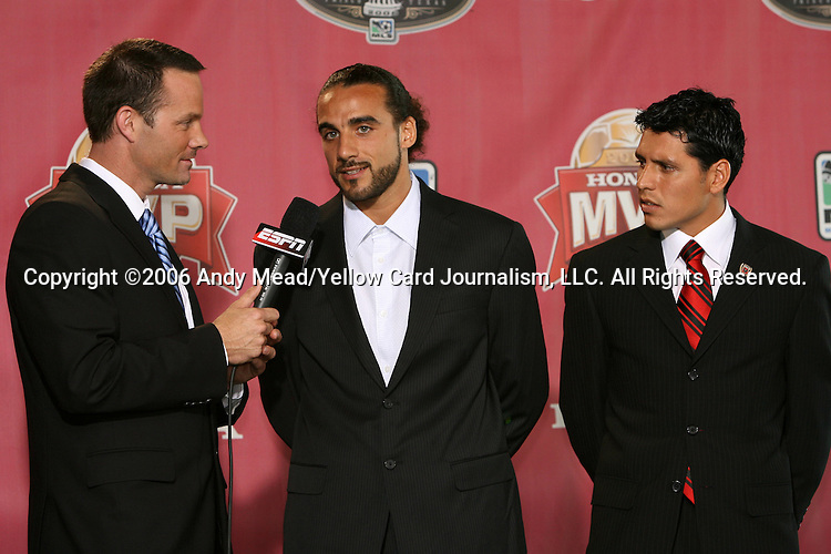 09 November 2006: Television commentator Eric Wynalda (l) talks with finalist, Houston Dynamo forward Dwayne De Rosario (CAN) (center), as Christian Gomez (ARG) (r) watches. D.C. United midfielder Christian Gomez was awarded the 2006 MLS Honda Most Valuable Player award during a live telecast on ESPNEWS from the Verizon Club at Pizza Hut Park in Frisco, Texas.