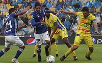 BOGOTÁ - COLOMBIA, 16-02-2019:Cristian Marrugo (Centro) jugador de Millonarios disputa el balón con Luis Cardoza (Der.) jugador del Atlético Huila  durante partido por la fecha 5 de la Liga Águila I 2019 jugado en el estadio Nemesio Camacho El Campín de la ciudad de Bogotá. /Cristian Marrugo (Center) player of Millonarios  fights for the ball with Luis Cardoza (R) player of Atletico Huila  during the match for the date 5 of the Liga Aguila I 2019 played at the Nemesio Camacho El Campin Stadium in Bogota city. Photo: VizzorImage / Felipe Caicedo / Staff.