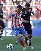 Atletico de Madrid's Gabi Fernandez (l) and Granada's Nolito during La Liga match.April 14,2013. (ALTERPHOTOS/Acero)