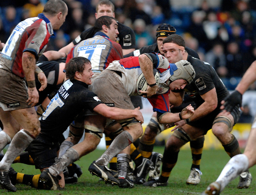 Photo: Richard Lane..London Wasps v Bristol Rugby. Guinness Premiership. 04/03/2007. .Bristol's Geraint Lewis is atckled by Wasps' Eion Reddan.