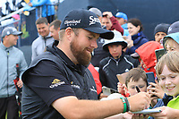 Shane Lowry (IRL) signing autographs on the 9th during the preview of the the 148th Open Championship, Portrush golf club, Portrush, Antrim, Northern Ireland. 17/07/2019.<br /> Picture Thos Caffrey / Golffile.ie<br /> <br /> All photo usage must carry mandatory copyright credit (© Golffile | Thos Caffrey)