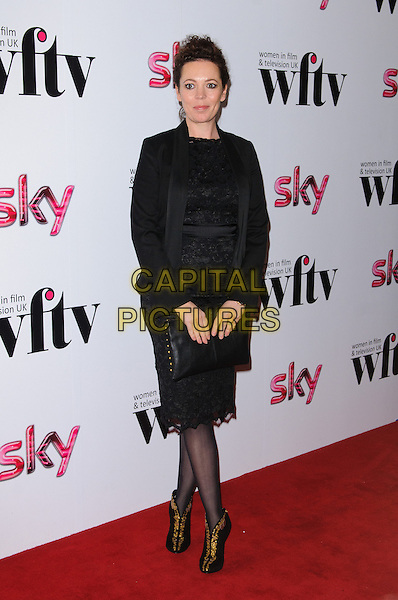 Olivia Colman.Women In Film & Television Awards 2012 held at the Hilton, London, England, UK, 7th December 2012..full length black lace dress jacket clutch bag tights gold ankle boots booties .CAP/CJ.©Chris Joseph/Capital Pictures.