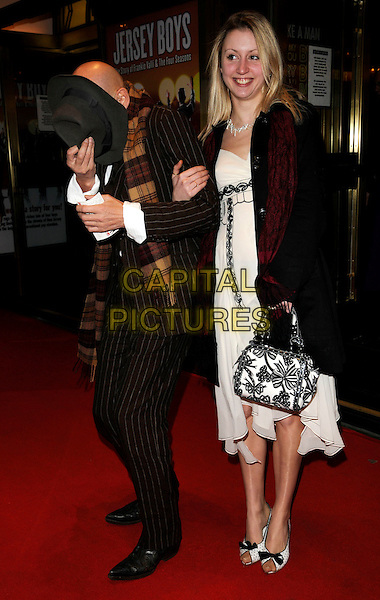"RICHARD O'BRIEN & GUEST.Attending the ""Jersey Boys"" Press Night  at the Prince Edward Theatre, London, England, March 18th 2008..full length hat funny hiding.CAP/CAN.©Can Nguyen/Capital Pictures"