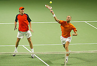 05-03-2006,Swiss,Freibourgh, Davis Cup , Swiss-Netherlands, Peter Wessels-Dennis van Scheppingen in action against Yves Allegro-George Bastl