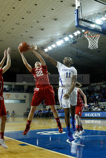 UK Forward Denesha Stallworth (11) and Bradley guard Catie O'Leary (11) reach for a rebound during the first half of UK Hoops vs. Bradley at Memorial Coliseum  in Lexington Ky., on Wednesday, November 27, 2013. Photo by Judah Taylor | Staff