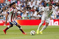 Sergio Ramos of Real Madrid and Raul Jimenez of Atletico de Madrid during La Liga match between Real Madrid and Atletico de Madrid at Santiago Bernabeu stadium in Madrid, Spain. September 13, 2014. (ALTERPHOTOS/Caro Marin)