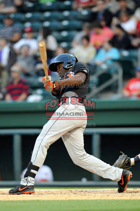 Outfielder Roderick Bernadina (11) of the Delmarva Shorebirds bats in a game against the Greenville Drive on Friday, April 26, 2013, at Fluor Field at the West End in Greenville, South Carolina. Delmarva won, 10-3. (Tom Priddy/Four Seam Images)