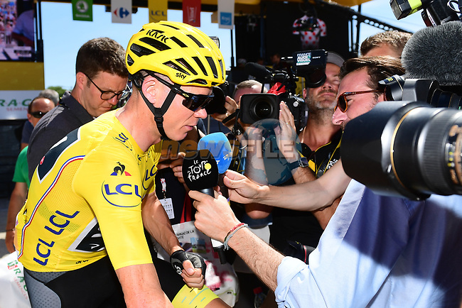 Race leader Christopher Froome (GBR) talks to the media at sign on before the start of Stage 6 of the 104th edition of the Tour de France 2017, running 216km from Vesoul to Troyes, France. 6th July 2017.<br /> Picture: ASO/Alex Broadway | Cyclefile<br /> <br /> <br /> All photos usage must carry mandatory copyright credit (&copy; Cyclefile | ASO/Alex Broadway)
