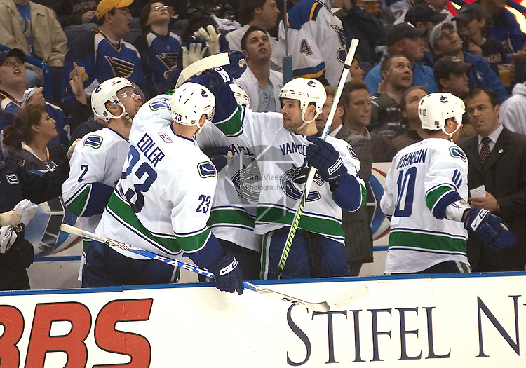 April 19 2009       Canucks players on the bench celebrate their team's second goal in the second period.   The St. Louis Blues hosted the Vancouver Canucks in the third playoff game between the two teams on Sunday April 19, 2009 at the Scottrade Center in downtown St. Louis, MO.  The Blues entered the game down 2-0 in the best of seven series.  ..            *******EDITORIAL USE ONLY*******