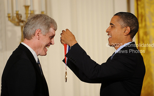 United States President Barack Obama awards Steven J. Sasson from Eastman Kodak Company, Rochester, New York, the National Medal of Science and the National Medal of Technology and Innovation in the East Room of the White House, Wednesday, November 17, 2010 in Washington, DC. .Credit: Olivier Douliery / Pool via CNP