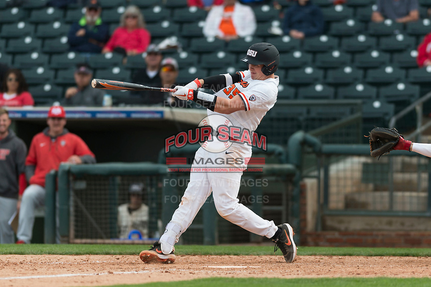 Oregon State Beavers catcher Adley Rutschman (35) swings at a pitch during a game against the New Mexico Lobos on February 15, 2019 at Surprise Stadium in Surprise, Arizona. Oregon State defeated New Mexico 6-5. (Zachary Lucy/Four Seam Images via AP)