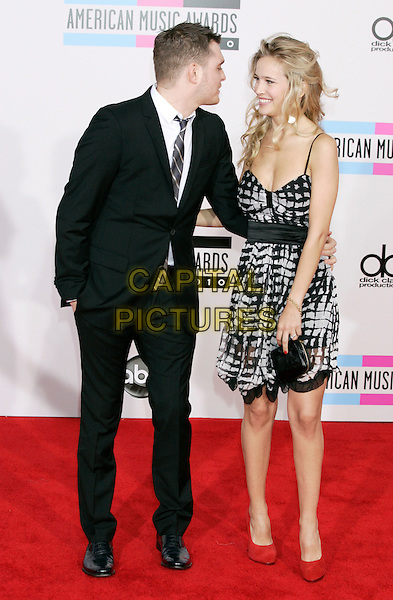 MICHAEL BUBLE & LUISANA LORELEY.Arrivals  to the 2010 American Music Awards held at Nokia Theatre L.A. Live in Los Angeles, California, USA..November 21st, 2010.AMA AMAS AMA'S full length couple fiance print dress suit grey gray red profile shoes blue tie white shirt black .CAP/PE.©Peter Eden/Capital Pictures.