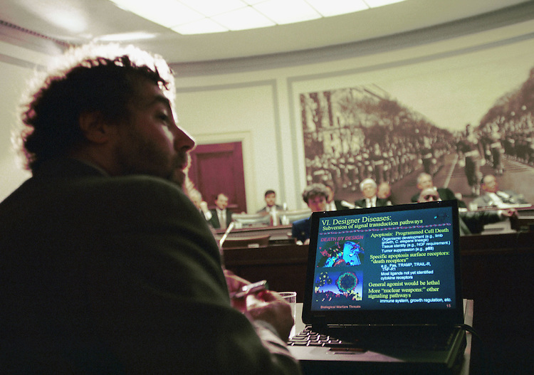 3/3/99.INTERNATIONAL BIOLOGICAL WARFARE--Dr. Stephen Block, biophysicist and professor of moecular biology at Princeton University, testifies during a hearing before the House Select Intelligence Committee. The laptop displays slides being projected on a screen for the members to see..CONGRESSIONAL QUARTERLY PHOTO BY SCOTT J. FERRELL