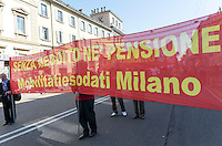 Corteo del primo maggio per la festa dei lavoratori. Milano, 1 maggio, 2014....                                              Labour Day Demonstration. Milan, May 1, 2014.