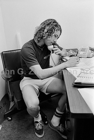 Skaterboard star Tony Alva on phone at his skateboard shop, Venice California, 1978. Photo by John G. Zimmerman.